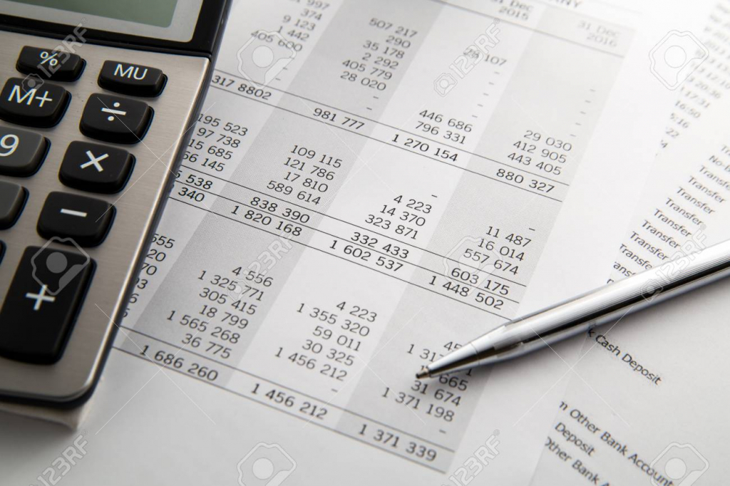 pen calculator on the financial account documents financial concept 10000 year calendar calculator